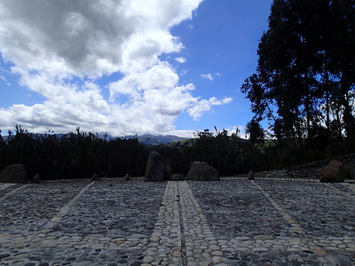 Quitsato Sundial, Cayambe. Equator line points directly to volcano lost in the clouds. It is used for a point of reference to determine time.